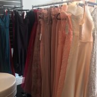 memphis design dresses on clothing rack