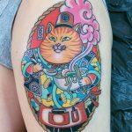 Tattoo of s cat wearing a komono and eating ramen