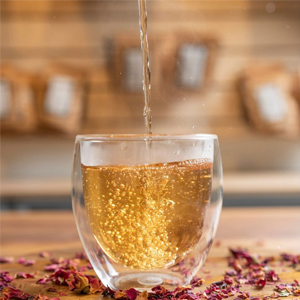 tea being poured into glass cup