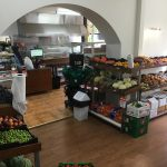 Inside a supermarket and deli with fresh fruit and vegetables
