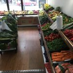 Inside a supermarket scene with fresh fruit and vegetables
