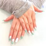 White and teal manicured nails