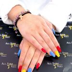 Red blue and yellow manicured nails