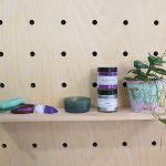 Shelf in craft store with resin products on
