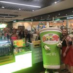 People at a Boost Juice bar with Boost Juice mascot