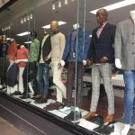 Mannequins wearing mens clothing