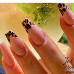 Close up of leopard print manicured nails