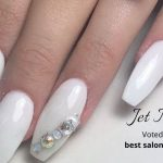 Close up of white diamonte manicured nails