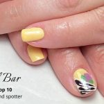 Close up of patterened manicured nails