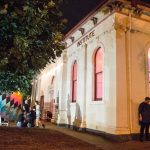 Outside Mechanics Institute building at night