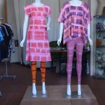 Mannequins wearing patterned outfits
