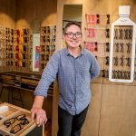 Male wearing glasses in glasses shop
