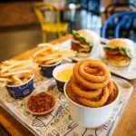 Burgers, fries and onion rings
