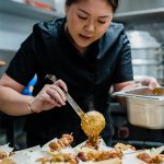 Young woman serving Vietnamese food