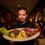 Mon holding plate of Lebanese cuisine