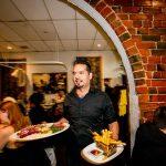 Man serving food in restaurant