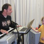 Man and child singing with keyboard