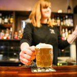 Waitress serving beer