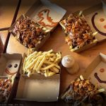 Fries with gravy in takeaway boxes