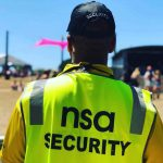 Back of a security officer in high vis