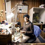 Man in workshop making gold jewellery