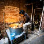 Man fireblasting gold jewellery