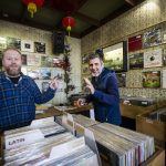 Record shop interior with two employees