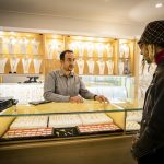 Shopping interaction in a gold jewellery shop