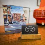Vintage store business cards on display