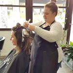 Hairdresser dying hair with foils