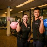 2 strong fit people with medicine balls