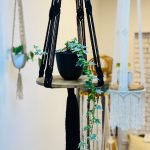 potted plants in macrame hangings