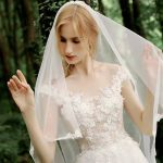 Bride in lacy wedding dress and veil