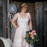Bride in urban setting with lacy dress