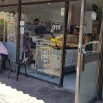 People sitting outside an icecream shop