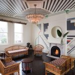 Art deco upstairs bar with fireplace and chandelier