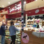 People purchasing bread