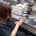 Woman fixing a watch