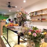 Flowers and fruit on a cafe counter