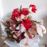 Red and pink floral bouquet in box
