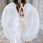 Bride flicking sides of dress up