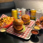 Burgers, fries, chicken bits and soda