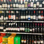 Rows of red wine on shelves