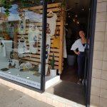Woman standing in shop doorway