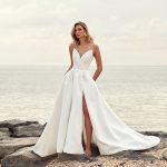 Woman in wedding dress at beach